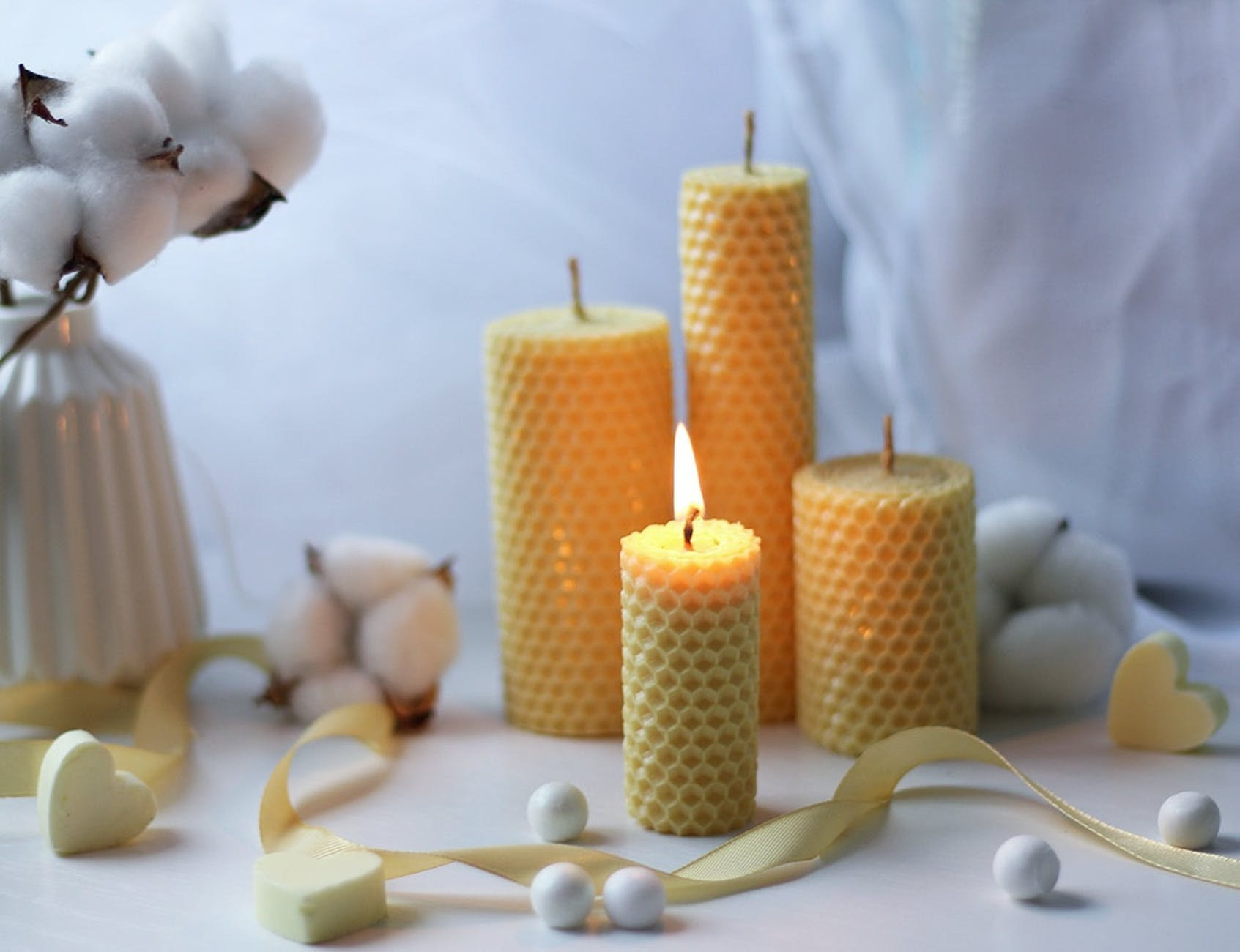 white candles on white table